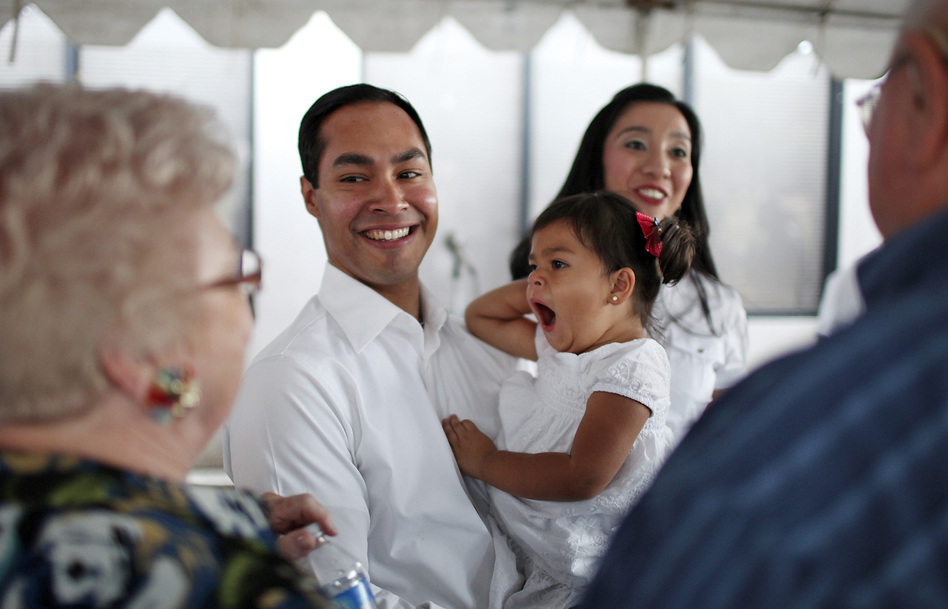 Mayor Julian Castro his daughter Carina, 2, and wife Erica (background) greet supporters at his campaign headquarters in 2011.