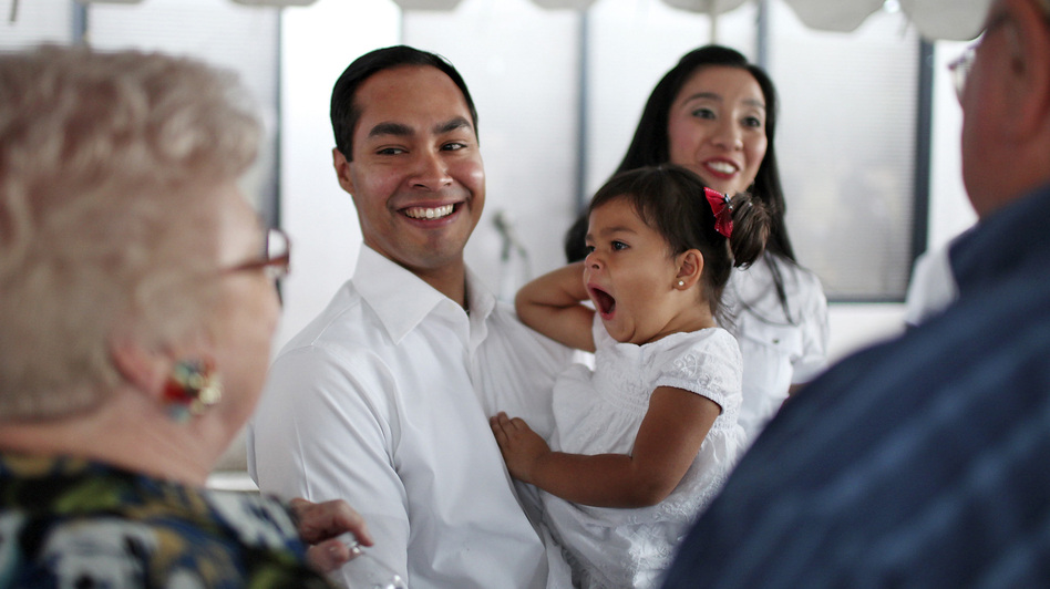 Mayor Julian Castro his daughter Carina, 2, and wife Erica (background) greet supporters at his campaign headquarters in 2011. (AP)