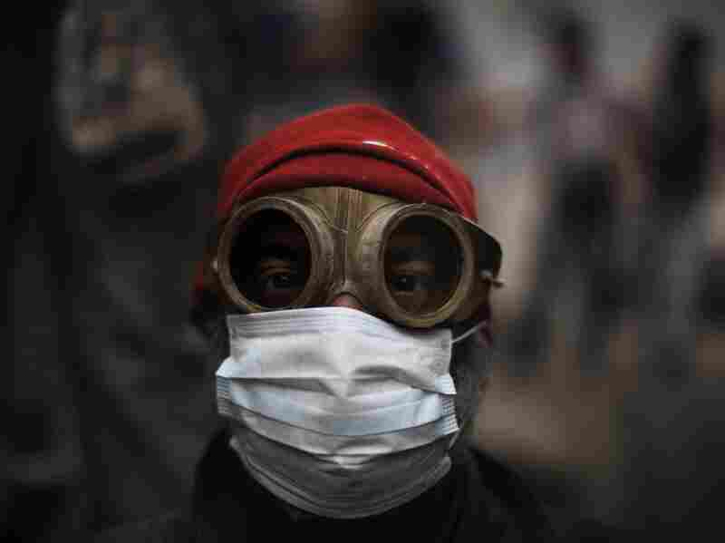 An Egyptian demonstrator uses goggles and a protective mask against tear gas fired by riot police during confrontations outside Cairo's security headquarters on February 6.