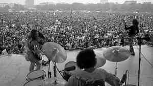 The members of Grand Funk Railroad, Don Brewer (drums), guitarists Mel Schacher (right) and Mark Farner play at a free concert in London's Hyde Park in 1971.