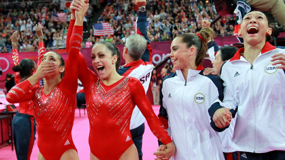 Alexandra Raisman, Jordyn Wieber, Mc Kayla Maroney and Kyla Ross (left-right) of the  U.S. women's gymnastics team celebrate their gold medal. (Getty Images)