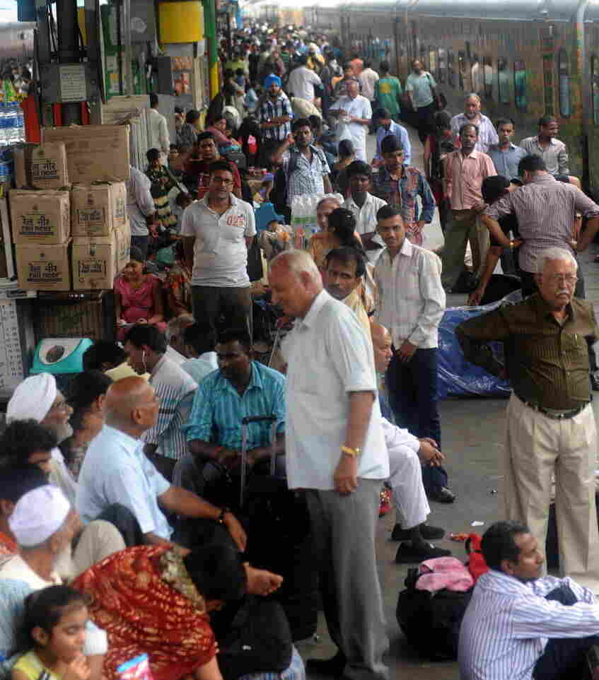 Passengers waited for trains Tuesday at a railway station in New Delhi. Another grid failure cut power, causing chaos.