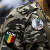 A soldier wears a button bearing the image of coup leader Capt. Amadou Haya Sanogo with the words 'President, CNRDRE,' the French acronym of the ruling junta, as he stands guard at junta headquarters in Kati, outside Bamako, Mali.