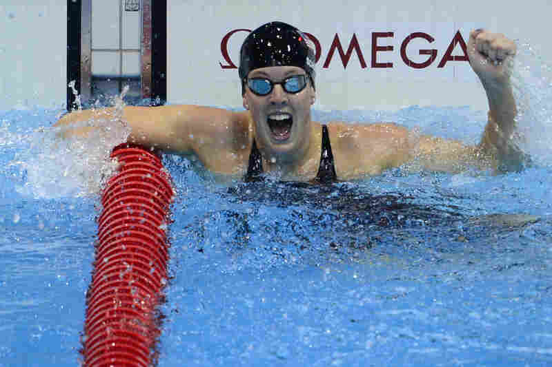 U.S. swimmer Allison Schmitt cheers after winning the women's 200m freestyle final.
