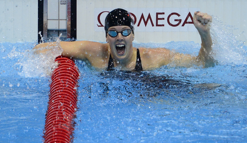 U.S. swimmer Allison Schmitt cheers after winning the women's 200m freestyle final. (AFP/Getty Images)