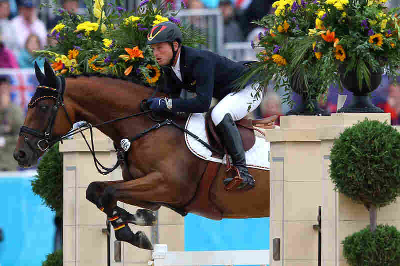 Michael Jung of Germany riding Sam negotiates a jump in the Individual Jumping Equestrian Final. Jung won the event.