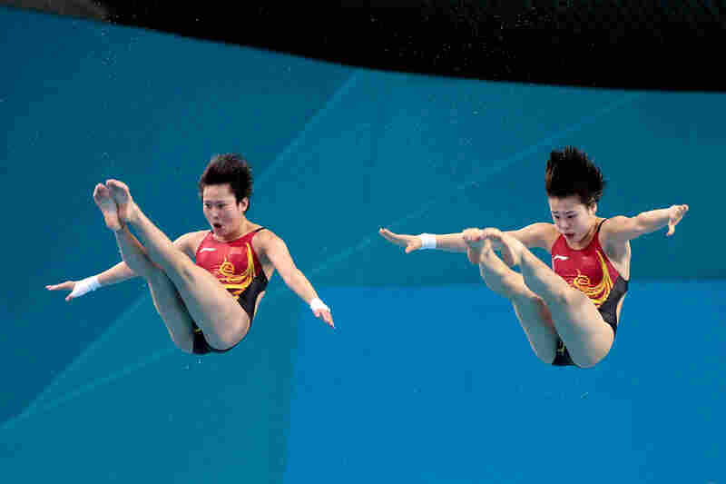 Chen Roulin and Hao Wang and of China compete in the Women's Synchronised 10m Platform Diving. Roulin and Wang won the event.