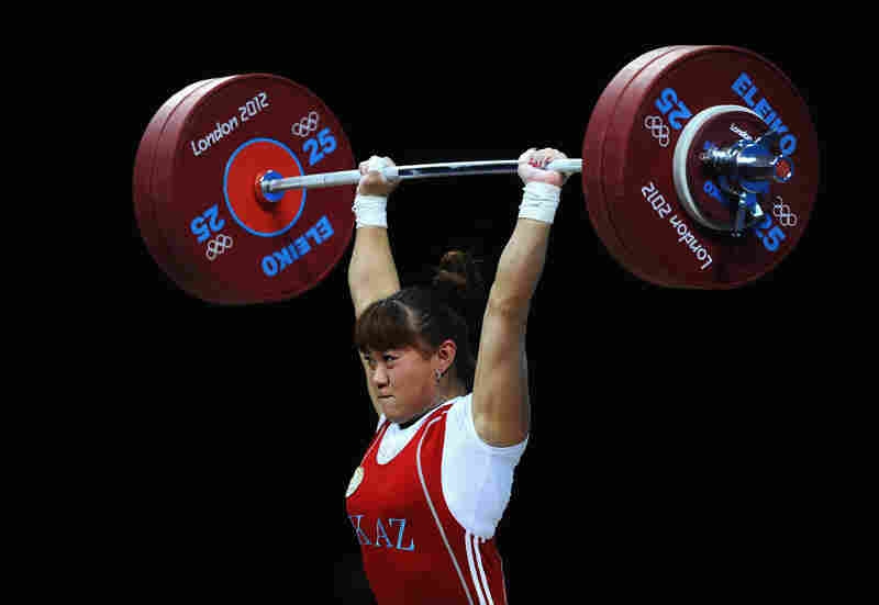 Maiya Maneza of Kazakhstan competes in the Women's 63kg Weightlifting final. She won the event.
