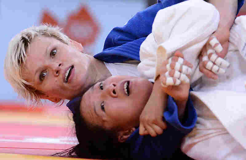 Slovenia's Urska Zolnir (in blue) competes with China's Lili Xu during their women's 63kg judo contest final match. Zolnir won the match.