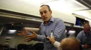 Dan Senor, senior national security aide to Mitt Romney, speaks to the press en route to Israel from London on Saturday.