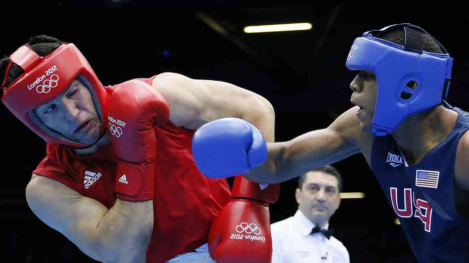 hide caption Boxer Michael Hunter Jr. of the U.S. lost a close bout to