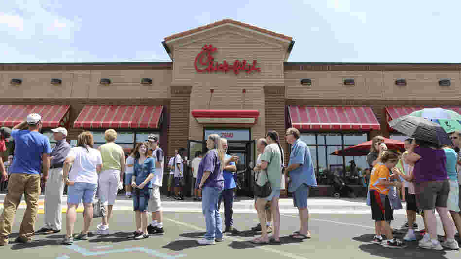 The line stretched into the parking lot today at a Chick-fil-A restaurant in Wichita, Kan.