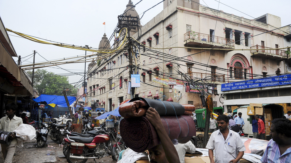 India's electric system is under constant stress and blackouts are common. Elliot Hannon was on the streets of New Delhi when power went out Tuesday, but he didn't realize there was an outage until later. (AFP/Getty Images)