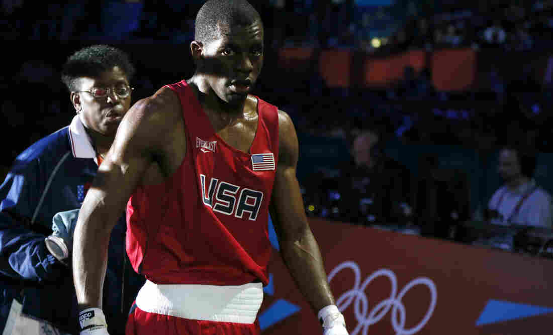 Jamel Herring of the U.S. departs the ring after his loss to Daniyar Yeleussinov in their boxing match at the London Olympics. Herring, an active-duty Marine, is the U.S. team captain.