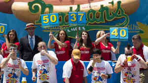 Five-time reigning champion Joey Chestnut, second from left, competes in Nathan's Famous Hot Dog Eating World Championship on July 4 this year.