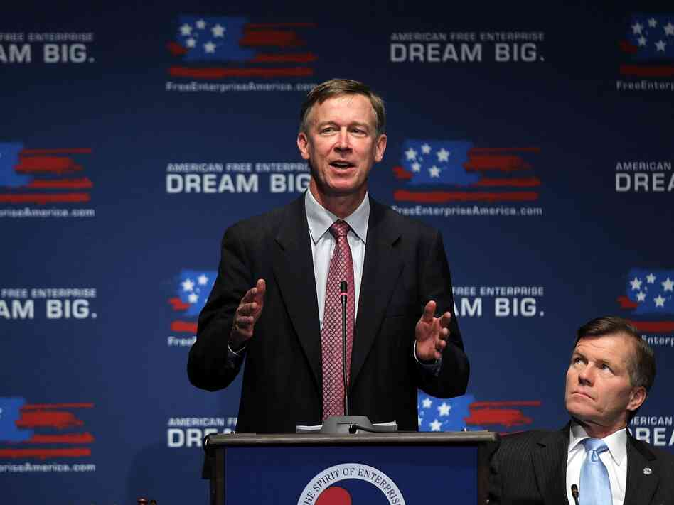 Governor of Colorado John Hickenlooper speaks as Governor of Virginia Bob McDonnell looks on during the 2011 Governors Summit at the U.S. Chamber of Commerce June 20, 2011 in Washington, D.C.