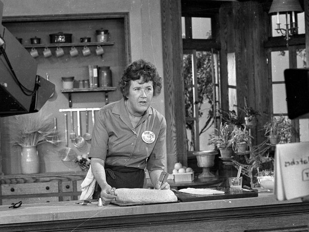 Julia Child prepares a French delicacy in her cooking studio on Nov. 24, 1970. (AP)