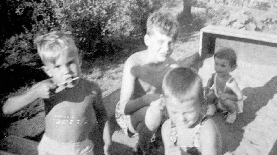 This undated family photo shows brothers David (left) and Ted Kaczynski (center) in a sandbox with neighbors. (AP)