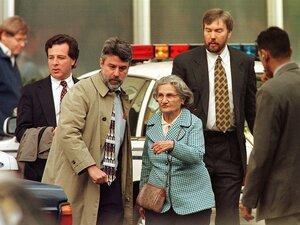 Wanda Kaczynski and her son David Kaczynski (right background) are escorted to their car by defense lawyers after Unabomber Theodore Kaczynski pleaded guilty Jan. 22, 1998, in Sacramento, Calif.