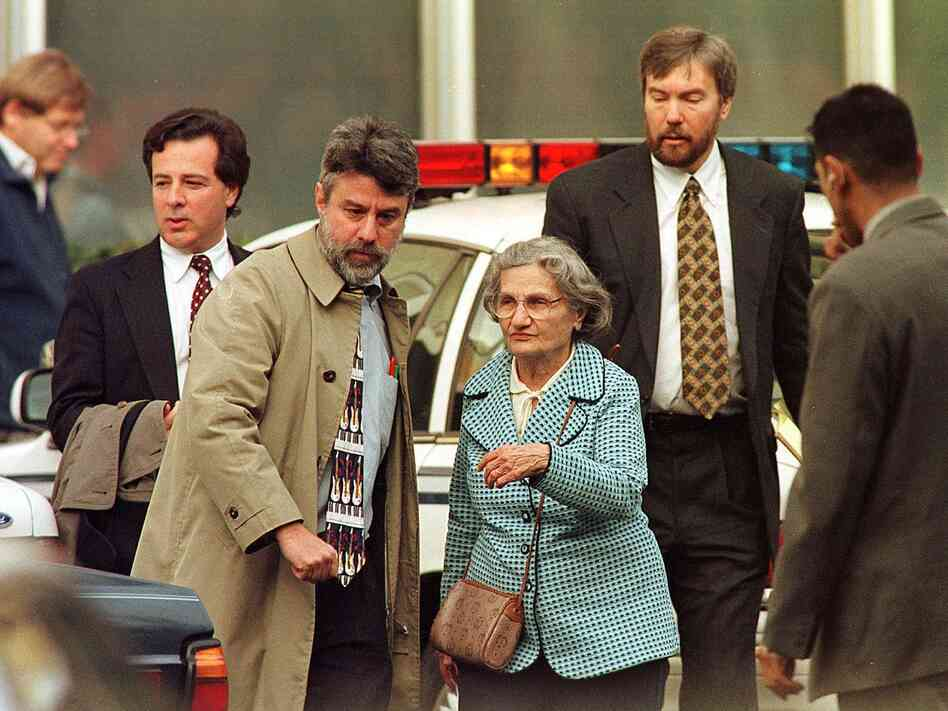 Wanda Kaczynski and her son David Kaczynski (right background) are escorted to their car by defense lawyers after Unabomber Theodore Kaczynski pleaded guilty Jan. 22, 1998, in Sacramento, Calif.