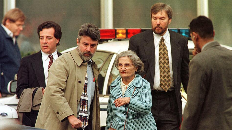 Wanda Kaczynski and her son David Kaczynski (right background) are escorted to their car by defense lawyers after Unabomber Theodore Kaczynski pleaded guilty Jan. 22, 1998, in Sacramento, Calif. (AFP/Getty Images)