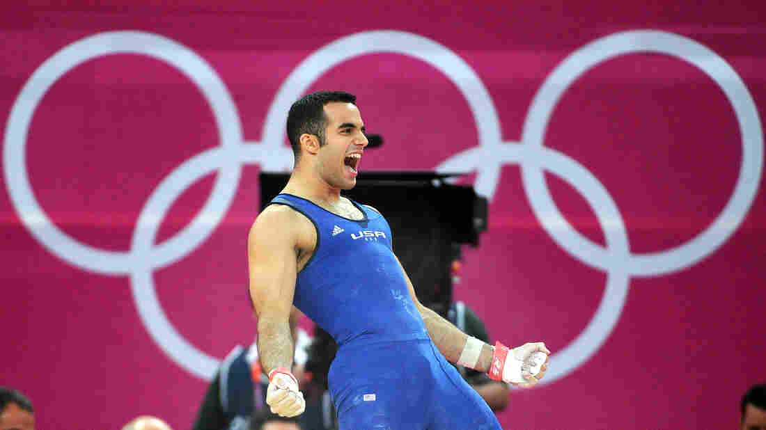Gymnast Danell Leyva of the United States celebrates after his final rotation in the men's individual all-around final.