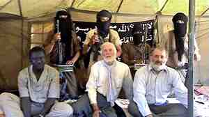 Former Canadian diplomat and U.N. envoy Robert Fowler (center, front row) was kidnapped in 2008 by al-Qaida in the Islamic Maghreb and held for more than four months. He says al-Qaida's recent rise in Mali should be seen as a serious threat to Western interests.