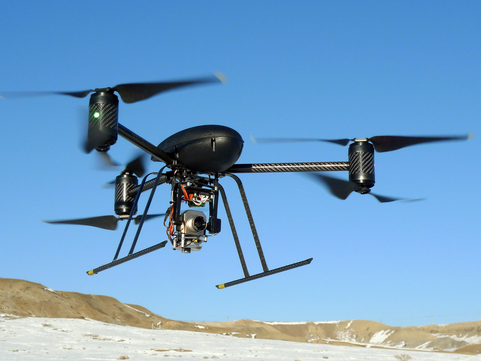 In this Jan. 8, 2009, photo provided by the Mesa County, Colo., Sheriff's Department, a small Draganflyer X6 drone makes a test flight in Mesa County, Colo. with a Forward Looking Infrared payload. The drone, which was on loan to the sheriff's department from the manufacturer, measures about 36 inches from rotor tip to rotor tip, weights just over two pounds.