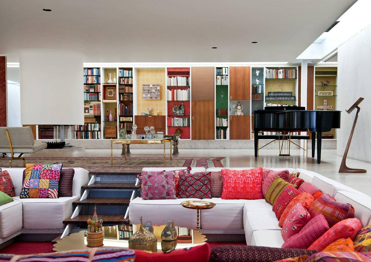 "Inside, the sunken ""conversation pit"" allows for plenty of seating without visual clutter. Architect and designer Alexander Girard worked with Will Miller's mother, Xenia Miller, on the house's interior decoration, which includes a selection of textiles that changes seasonally and a 50-foot-long storage wall."