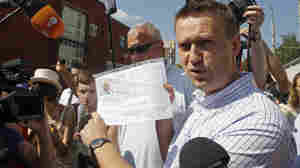 Russian protest leader Alexei Navalny speaks to the media as he arrives for questioning at the headquarters of the Russian Investigation committee in Moscow on Monday.