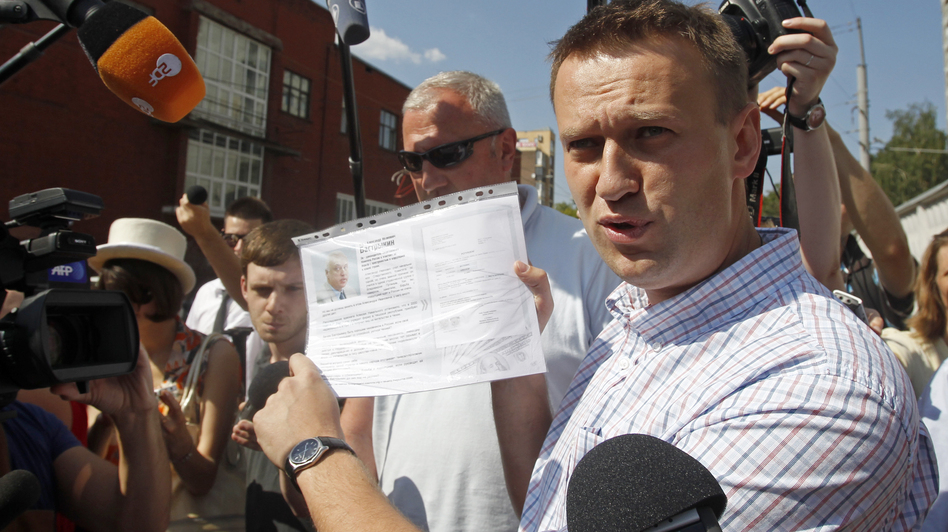 Russian protest leader Alexei Navalny speaks to the media as he arrives for questioning at the headquarters of the Russian Investigation committee in Moscow on Monday. (AP)