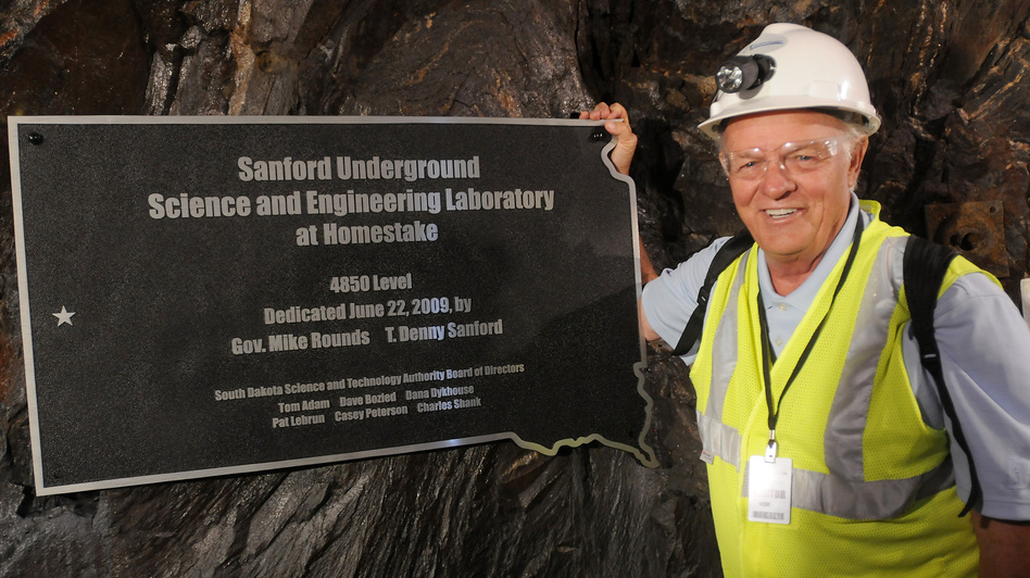Businessman and philanthropist T. Denny Sanford has pledged $70 million to the Sanford Underground Science and Engineering Laboratory. He stands next to a plaque dedicating the 4,850 foot level, where several experiments will be set up, in 2009. (AP)