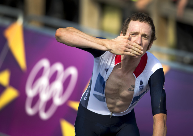 Britain's Bradley Wiggins celebrates after winning the gold medal at the end of the London 2012 Olympic Games men's individual time trial road cycling event in London.