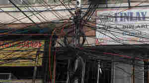 Plenty of wires. But where's the juice? This electric pole in Kolkata is typical of many in heavily populated India.