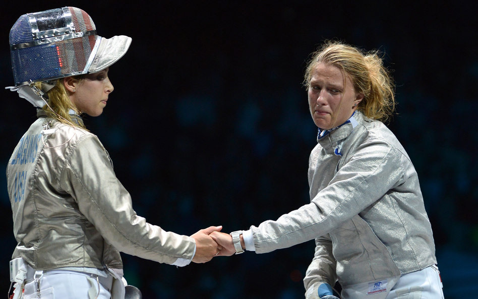 American fencer Mariel Zagunis (left), the two-time gold medal winner in sabre, shakes hands after losing to Ukraine's Olga Kharlan in their bronze medal match at London's ExCel Center.