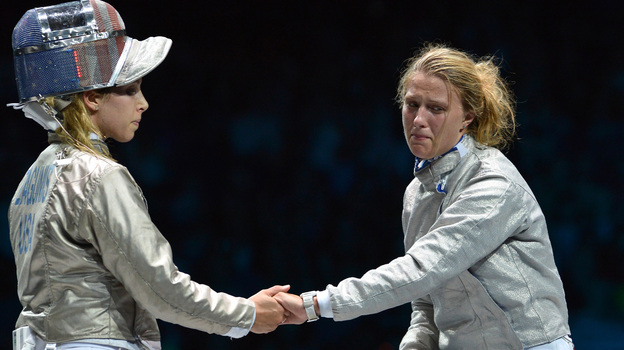 American fencer Mariel Zagunis (left), the two-time gold medal winner in sabre, shakes hands after losing to Ukraine's Olga Kharlan in their bronze medal match at London's ExCel Center. (AFP/Getty Images)