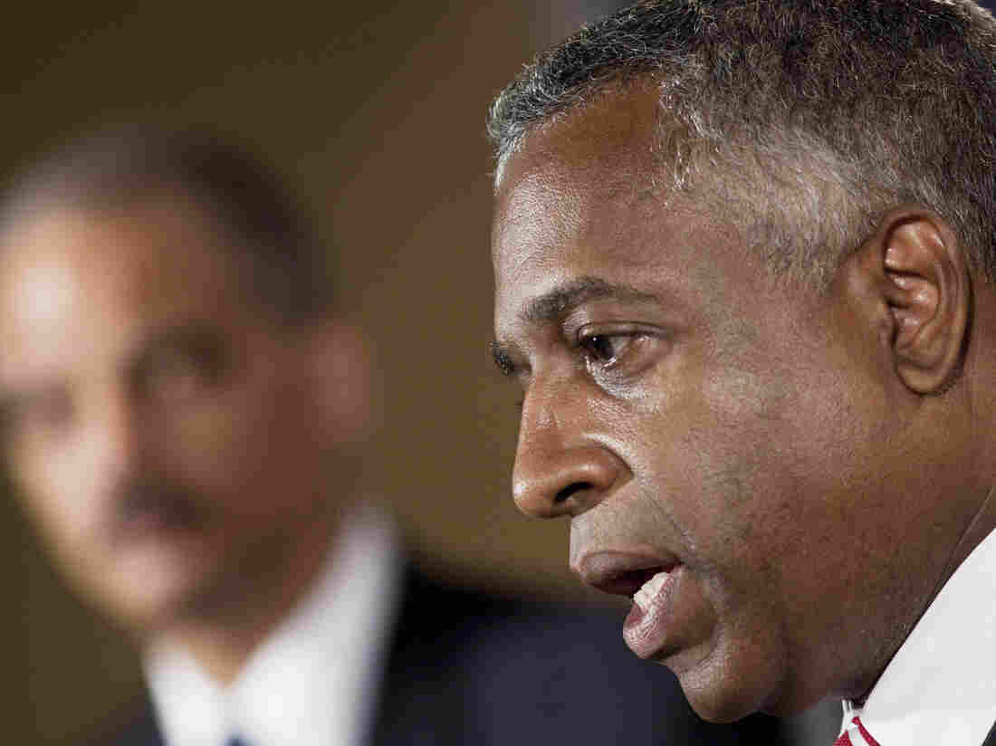 B. Todd Jones, acting director of the ATF, speaks in Washington in 2010 while Attorney General Eric Holder looks on.