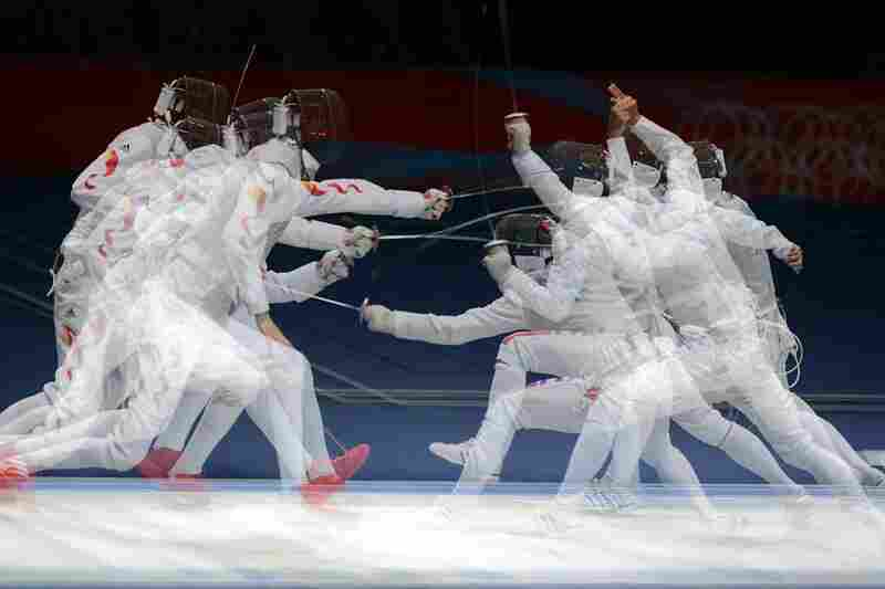 China's Lei Sheng (left) competing against Italy's Andrea Baldini during the men's fencing semi-final