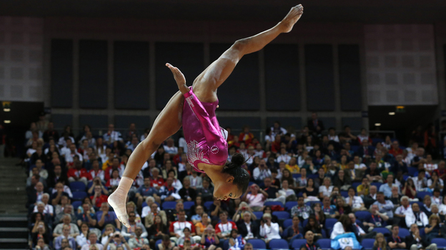 Gabrielle Douglas performs Thursday on the beam during the artistic gymnastics women's individual all-around final. Some people are focusing on her hair rather than her skill. (AFP/Getty Images)