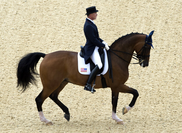 Jan Ebeling of the U.S. on Rafalca competes in the Dressage preliminaries of the London 2012 Olympic Games.