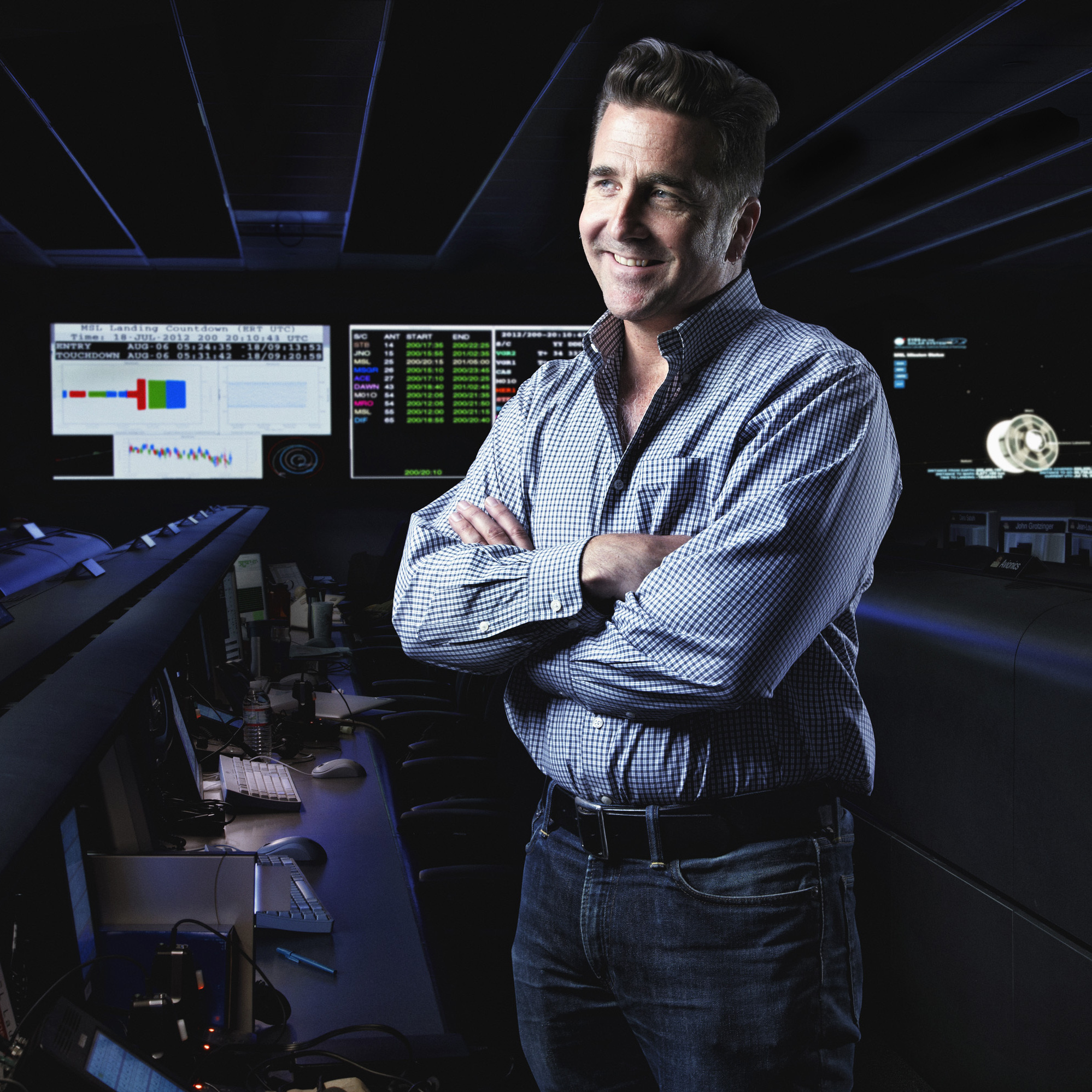 "Adam Steltzner led the team that dreamed up a new way to land on Mars. If their ""rover on a rope"" idea fails, the mission will, too. He's seen here in a photo illustration composed of two photos taken in the same spot in the control room at NASA's Jet Propulsion Laboratory in Pasadena, Calif."
