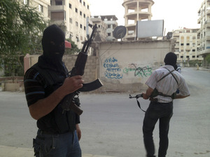 Members of the Free Syrian Army are seen in a neighborhood of Damascus, Syria on June 28. Several huge suicide bombings this year suggest al-Qaida or other extremists are joining the battle against President Bashar Assad's regime.