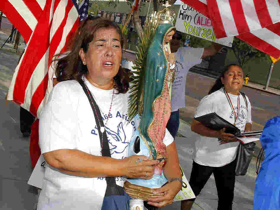 Rosa Maria Soto protests Maricopa County Sheriff Joe Arpaio outside the federal courthouse on July 19 in Phoenix. It was the first day of a trial that accuses Arpaio's office of racially profiling Latinos.