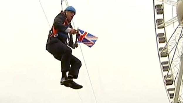 A still image taken from an eyewitness video shows London's Mayor Boris Johnson hanging from a zipline, after losing his momentum. (YouTube)