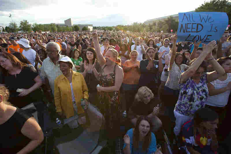 Thousands gather during a vigil for the shooting victims at the Aurora Municipal Center on July 22.