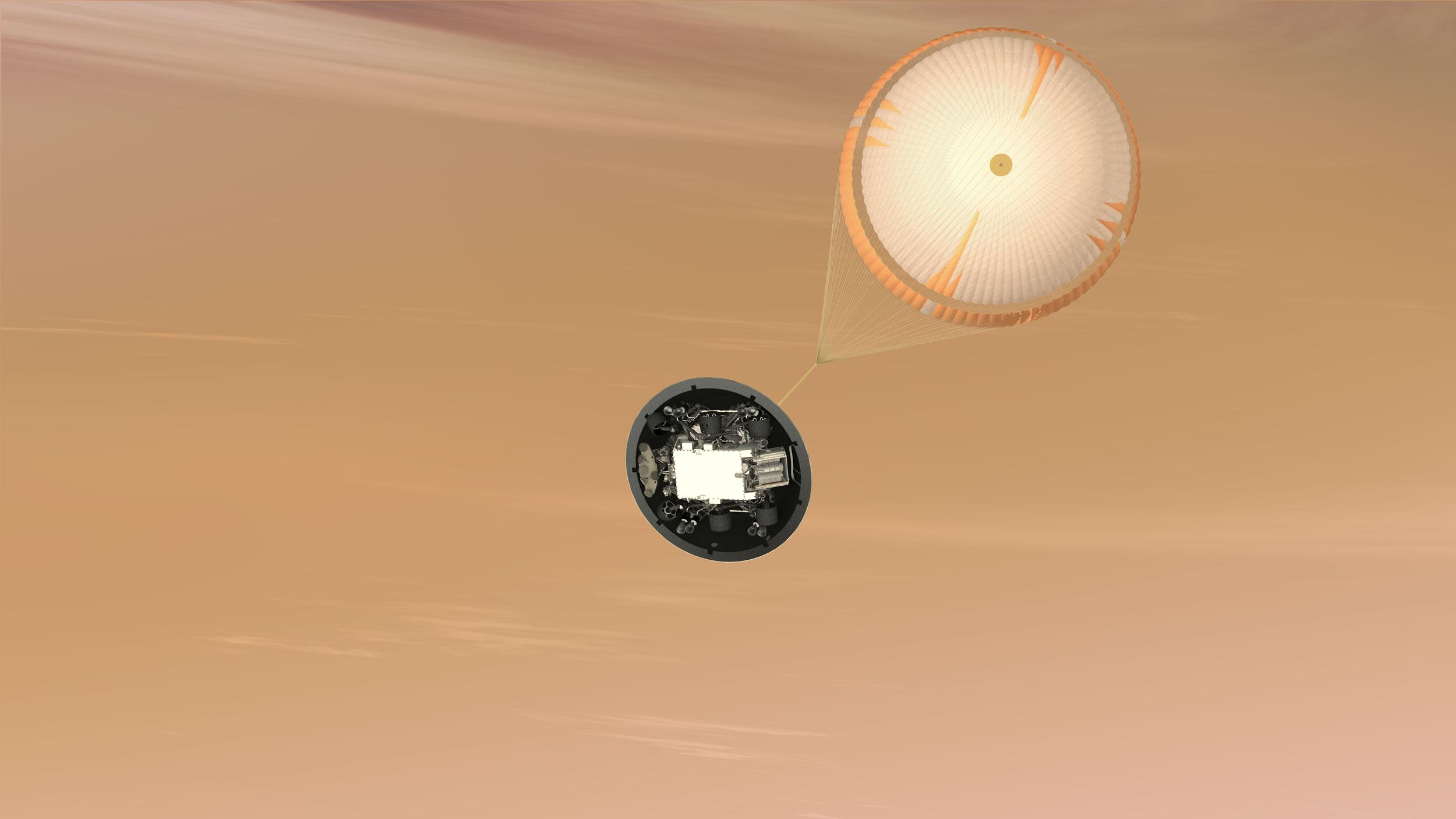 A parachute more than 50 feet across pops out, adding a bit more braking as the craft sinks into Mars's lower atmosphere.