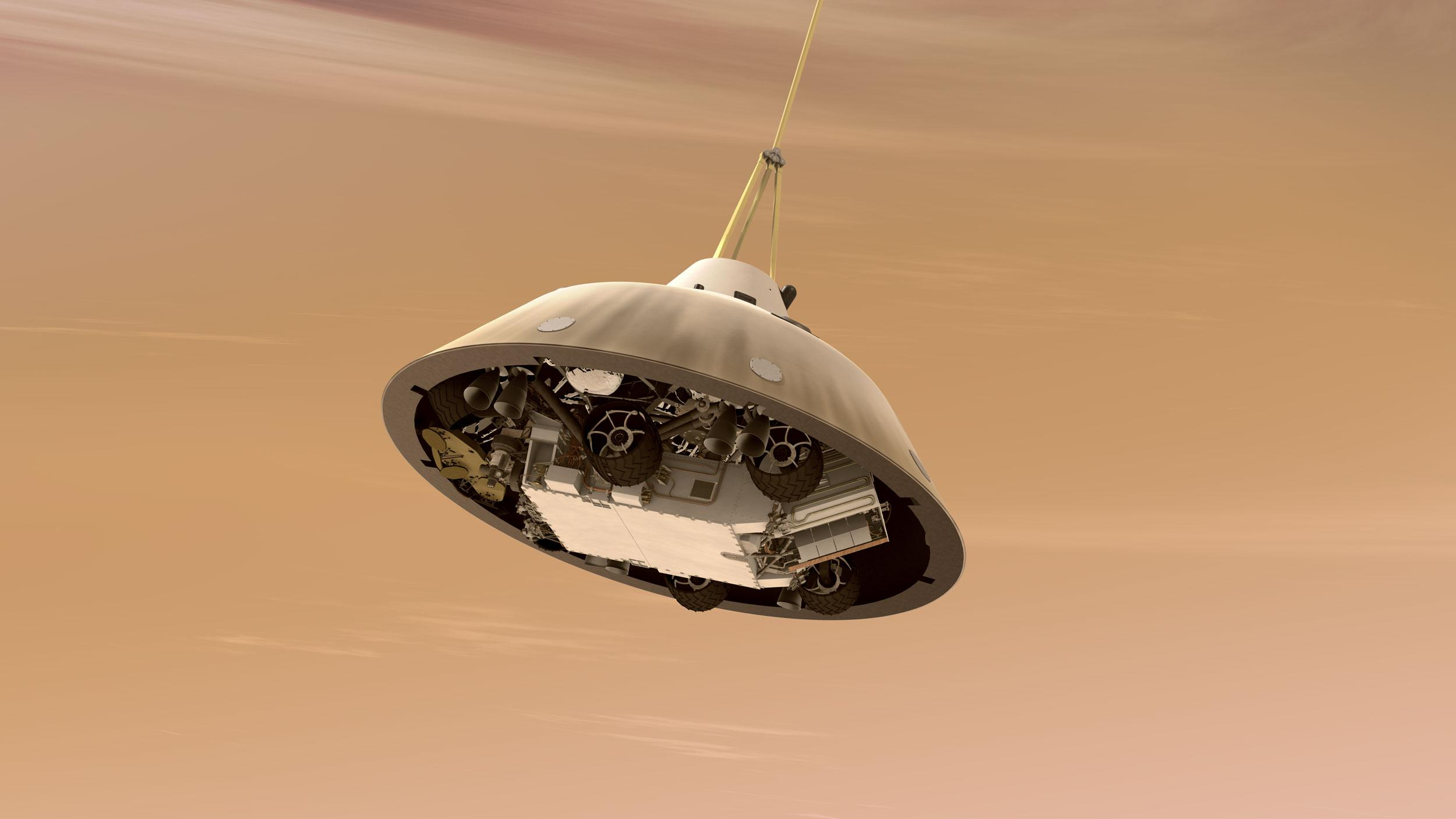 With the heat shield jettisoned, the rover can be seen tucked into the backshell of the spacecraft.