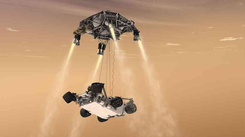 "Here's where things get crazy. A new ""sky crane"" lowers the rover on three cables while hovering above the surface."