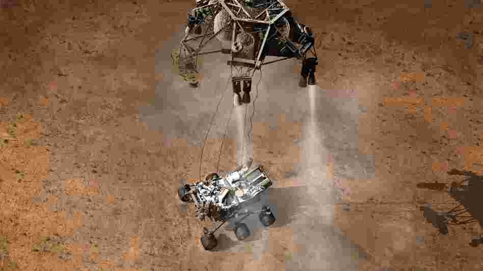 Once the sky crane senses that it's no longer supporting the rover, it releases the cables and flies off to crash-land a safe distance away. Curiosity is now free to explore its new home.