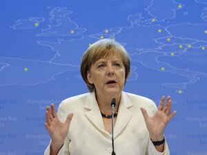 German Chancellor Angela Merkel speaks during a press conference during a second day of the European Union leaders summit in Brussels on June 29.